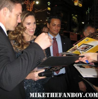 Hilary Swank arrives the new years eve world movie premiere and signs autographs for fans