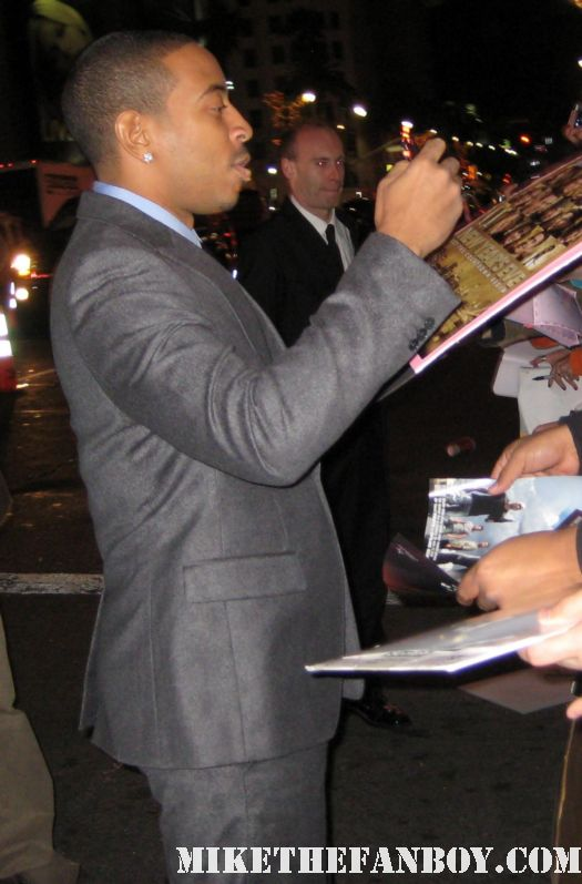 Ludacris arrives the new years eve world movie premiere and signs autographs for fans