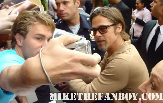 brad pitt signing autographs for fans at the kung foo panda 2 premiere in los angeles rare