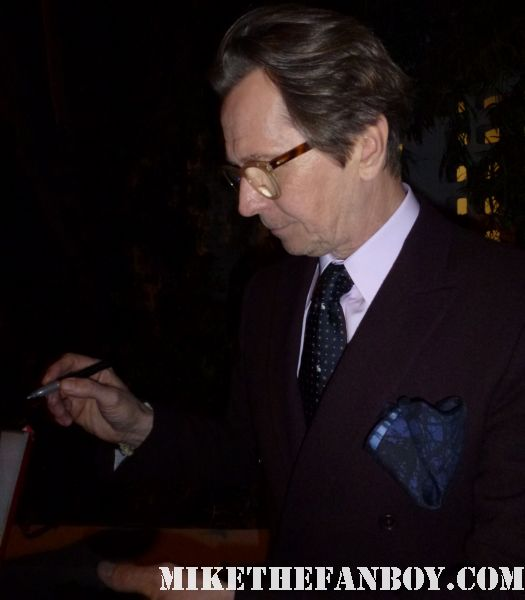 gary oldman signing autographs tinker tailor soldier spy movie poster  tinker tailor soldier spy world movie premiere red carpet with mark strong colin firth and gary oldman
