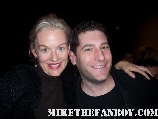 penelope ann miller with mike the fanboy posing for a fan photo at a screening of the artist adventures in babysitting  I'm going to spike her tab with draino