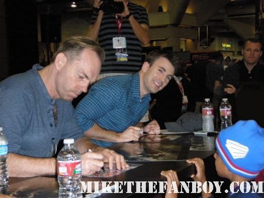 chris evans and hugo weaving signing autographs at the marvel booth at san diego comic con 2011