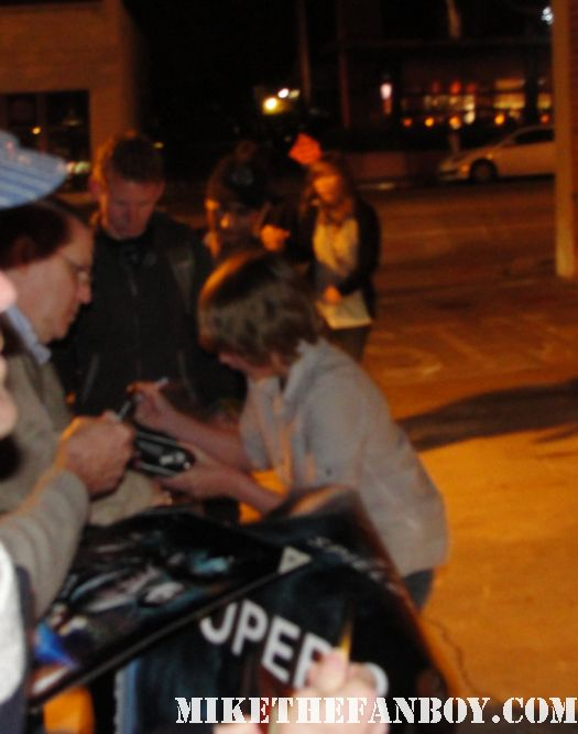 ryan lee signing autographs for fans outside a screening of super 8 at the aero theatre in santa monica