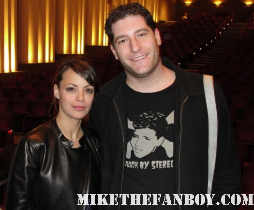 Berenice Bejo the artist star posing for a photo with mike the fanboy at a q and a of the artist