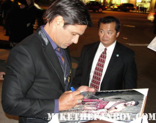 Manu Bennett who plays Crixus signing autographs for fans at the spartacus vengeance world movie premiere hot sexy gladiator