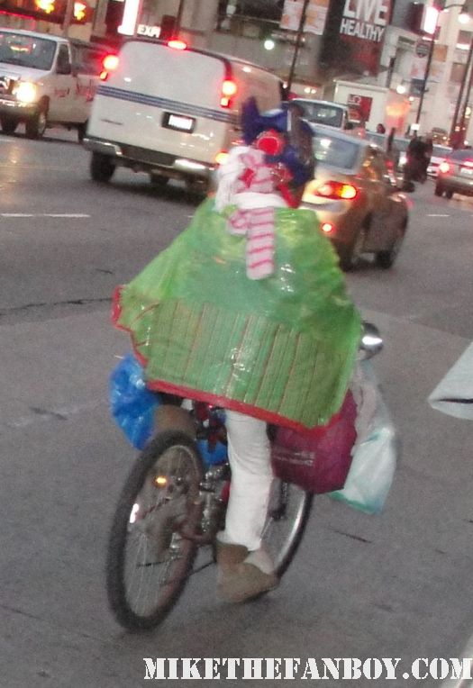 crazy man in a green shower curtain riding his bike down hollywood blvd rare crazy man on hollywood