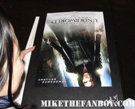erica and scotty getting their underworld awakening mini posters ready to get signed by kate beckinsale