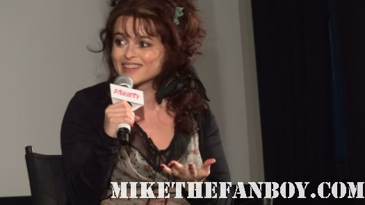 helena bonham carter stops to sign autographs for fans at a harry potter q and a rare promo