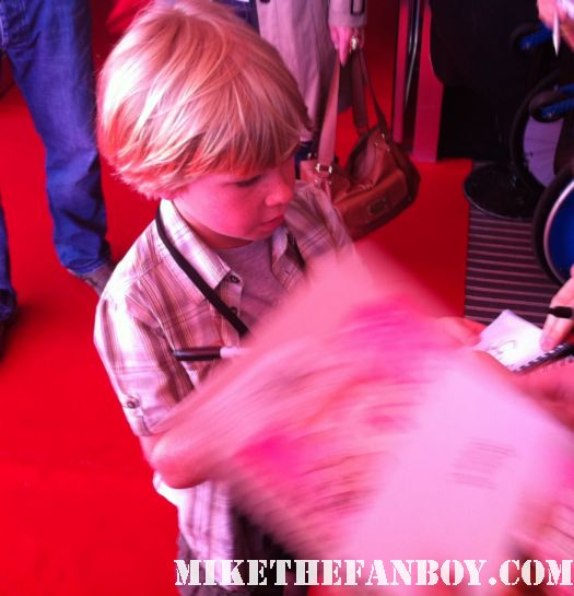 Bindi Irwin and robert irwin sign autographs at the puss in boots australian movie premiere
