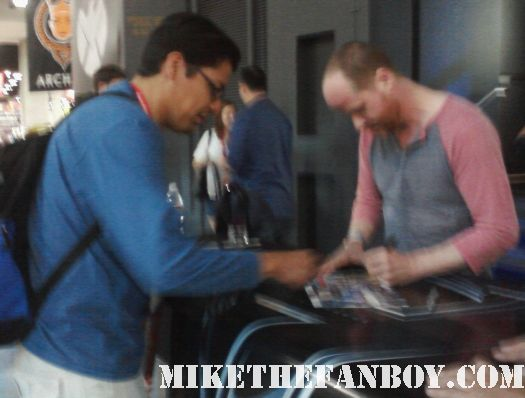 buffy the vampire slayer and avengers director creator joss whedon signing autographs at san diego comic con 2011