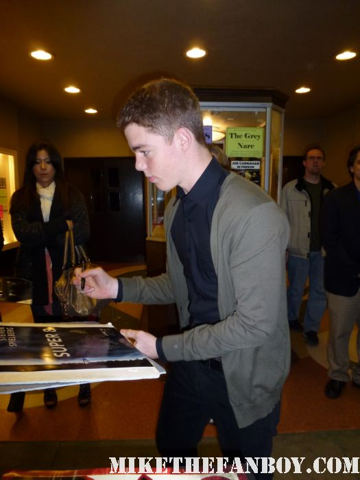 Gabriel Basso from super 8 and the big c signing autographs for fans outside a screening of super 8 at the aero theatre in santa monica