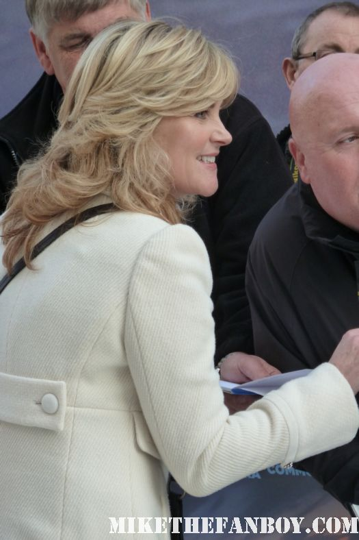 Anthea Turner signs autographs for fans at the happy feet 2 world movie premiere in the united kingdom london