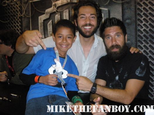 zach levi and Joshua Gomez from the cast of chuck signs autographs for fans and poses for photos at san diego comic con 2010 sdcc 2010 signed autographs rare promo