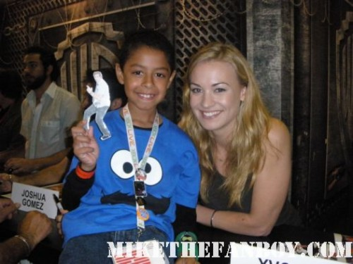 Yvonne Strahovski from the cast of chuck signs autographs for fans and poses for photos at san diego comic con 2010 sdcc 2010 signed autographs rare promo