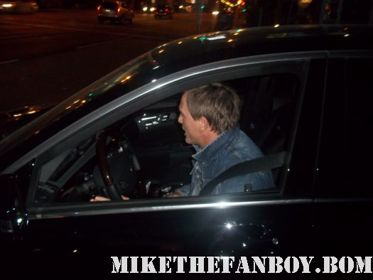 daniel craig stops his car to sign autographs for fans on the set of girl with the dragon tatoo
