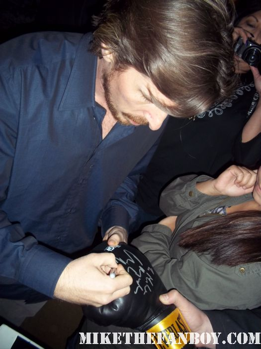 Christian Bale signing autographs for fans before a screening of the fighter at the arclight theatre