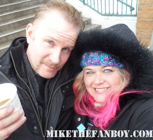morgan spurlock poses with pinky for a fan photo at sundance 2012 signed autograph rare