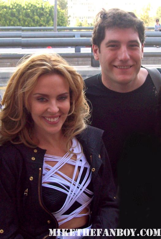 mike the fanboy poses with pop superstar Ms. Kylie minogue on the video shoot for all the lovers from aphrodite