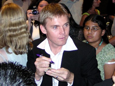 Ricky Schroder signing autographs for fans at a movie premiere nypd blue silver spoons