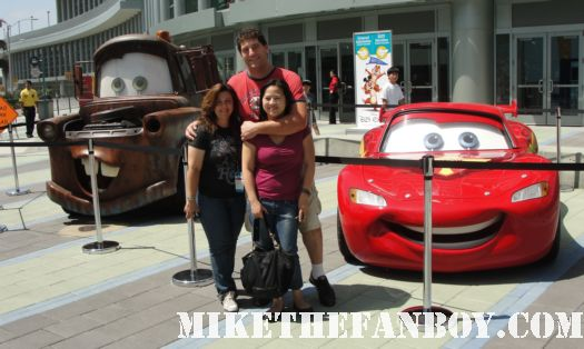 mike the fanboy with the lovely erica and suddenly susan at the D23 expo in anaheim posing with cars 2 lightning mcqueen and mater
