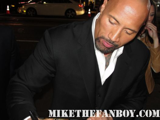 dwayne the rock johnson signing autographs for fans at the journey 2 world movie premiere hot sexy rare promo signed mini poster promo the tooth fairy