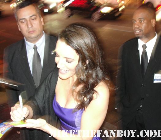 sexy and the city's charlotte york aka kristen davis signing autographs for fans at the journey 2 world movie premiere in los angeles