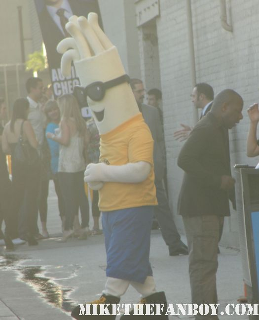a man in a noodle costume walking around the streets of hollywood while I wait for Joaquin Phoenix