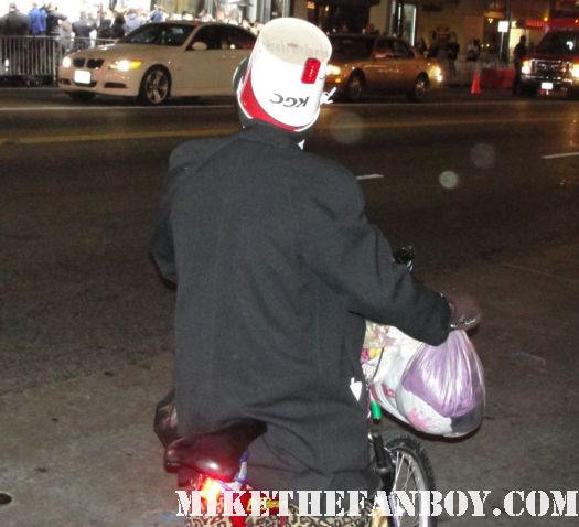 a man riding his bike in hollywood with a kentucky fried chicken bucket strapped to his head crazy homeless people