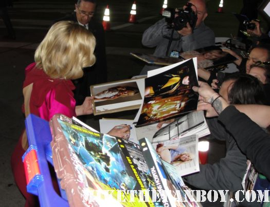 Malin Akerman signing autographs for fans at the wanderlust movie premiere in Westwood