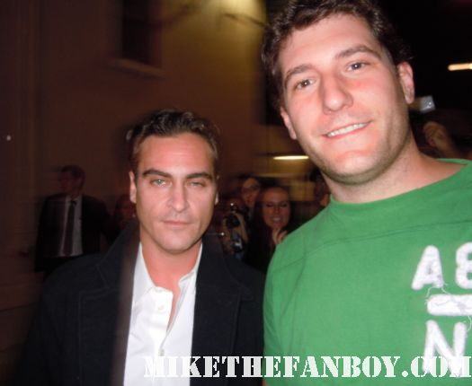 Joaquin Phoenix poses for a fan photo with mike the fanboy after signing autographs for fans hot sexy