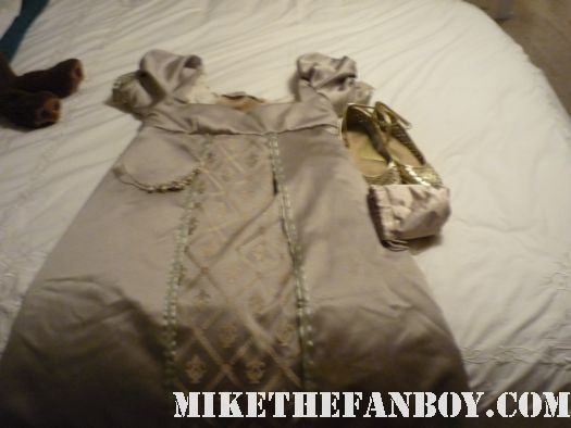 Dress on Bed the novel strumpet from mike the fanboy putting on a tam preparing to go to the jane austin ball in los angeles put on by theSociety for Manners and Merriment in the district of Los Angeles known as Pasadena