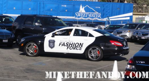 the fashion force police car at a man standing on top of the tent for the the 2011 Independent Spirit Awards tent rare on santa monica beach rare promo 2011 annette benning