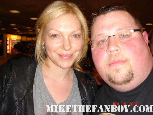 Chuck our man in texas poses with Laure Prepon at sundance 2012 autographs signed that 70's show my name is chelsea