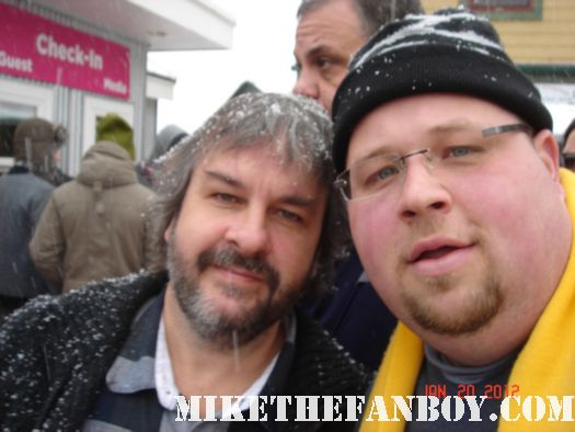 Chuck our man in texas poses with peter jackson director of lord of the rings at sundance 2012 autographs signed