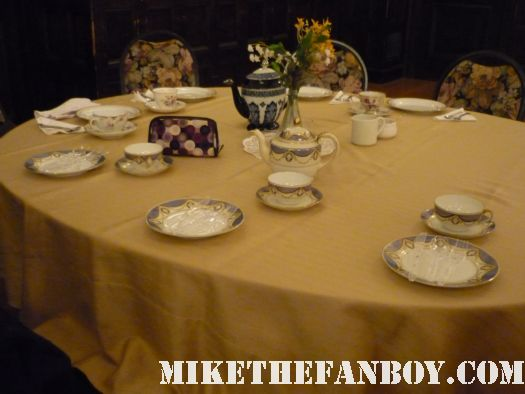Tea setting at the novel strumpet from mike the fanboy putting on a tam preparing to go to the jane austin ball in los angeles put on by theSociety for Manners and Merriment in the district of Los Angeles known as Pasadena