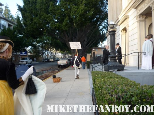 Walking away Occupy Regency protestor at he novel strumpet from mike the fanboy putting on a tam preparing to go to the jane austin ball in los angeles put on by theSociety for Manners and Merriment in the district of Los Angeles known as Pasadena