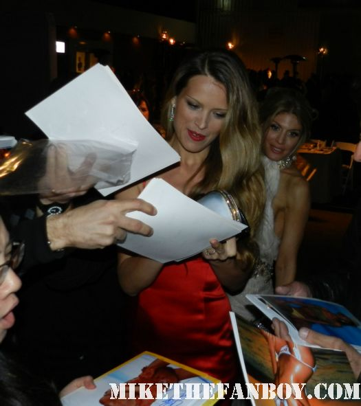 """random sport illustrated model signing autographs for fans at the The Art of Elysium """"Pieces of Heaven"""" Art Auction signed autograph I am number 4"""
