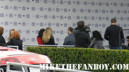 the press filing in to the  sand at the santa monica beach at the Independent Spirit Awards 2012 sand is evil