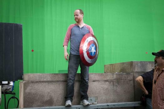 joss whedon holding captain america 's shield in the avengers rare press promo still green screen rare