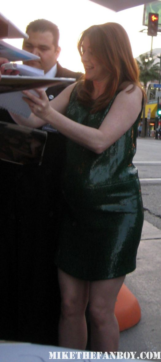 sexy alyson hannigan signing autographs for fans at the american reunion premiere red carpet promo with seann william scott eugene levy alyson hannigan jason biggs