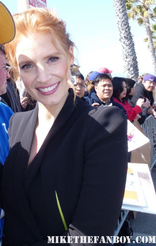 jessica chastain signing autographs for fans and posing for fan photos at the chateau marmount