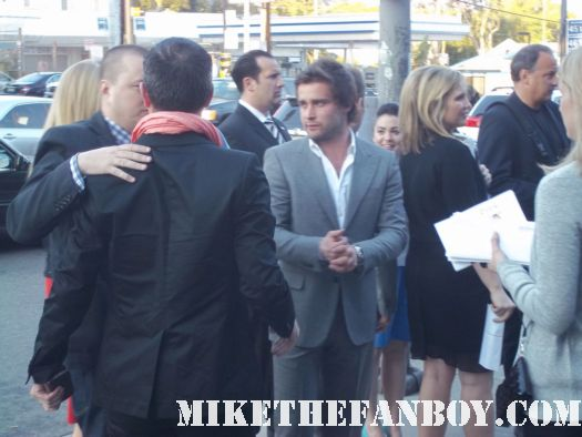starz magic city world premiere at the DGA theatre in hollywood jeffrey dean morgan signing autographs for fans at the magic city premiere at the dga in hollywood