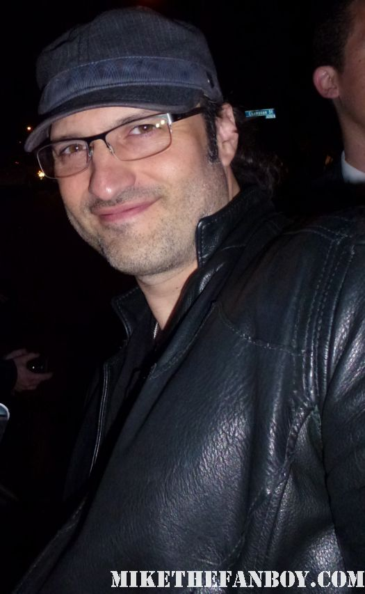 Robert Rodriguez  signing autographs for fans at the indie spirit awards and posing for fan photos
