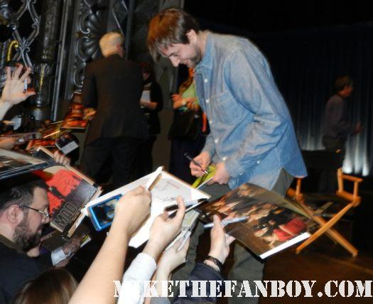 Vincent Kartheiser signing autographs for fans at the mad men 2012 paleyfest panel