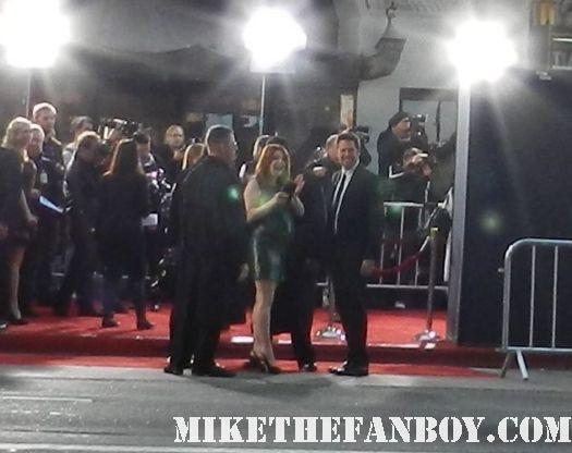 alyson hannigan signing autographs at the american reunion movie premiere red carpet with alyson hannigan jason biggs seann william scott  eugene levy chris klein