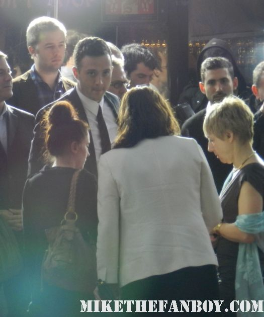 eddie kaye thomas and jason biggs signing autographs at the american reunion movie premiere red carpet with alyson hannigan jason biggs seann william scott  eugene levy chris klein