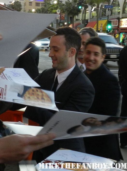 eddie kaye thomas and jason biggs signing autographs at the american reunion movie premiere red carpet with alyson hannigan jason biggs seann william scott  eugene levy chris klein