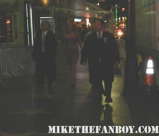 jennifer coolidge signing autographs at the american reunion movie premiere red carpet with alyson hannigan jason biggs seann william scott  eugene levy chris klein