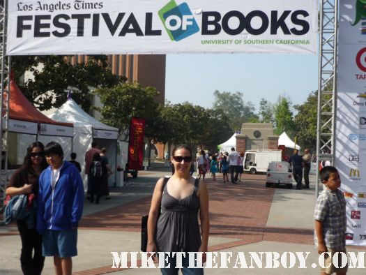 The novel Strumpet under the los angeles times festival of books sign at ucla campus day 1 2012