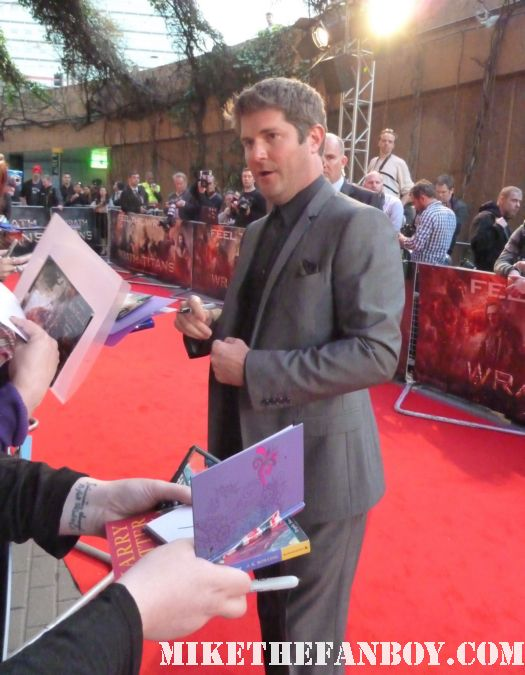 Jonathan Liebesman signing autographs at the red carpet of the wrath of the titans world movie premiere rare promo director of wrath of the titans
